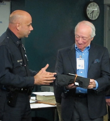 Bob receives award from Captain Rodriguez Of Newton Division LAPD