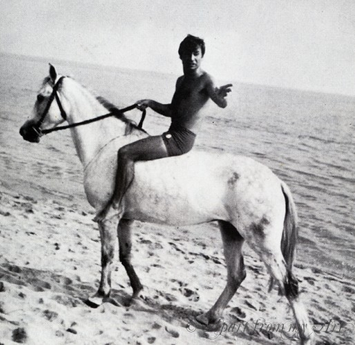 "Director Serge Bourguignon on horseback directing ""Picasso Summer"""