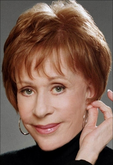 A photograph of Carol Burnett pinching her ear.