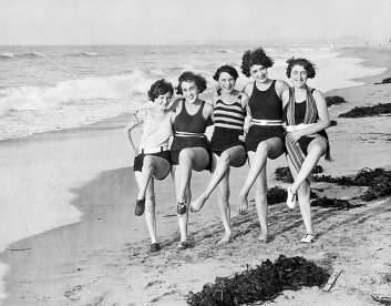 Vintage photo of 5 women dancing on the beach