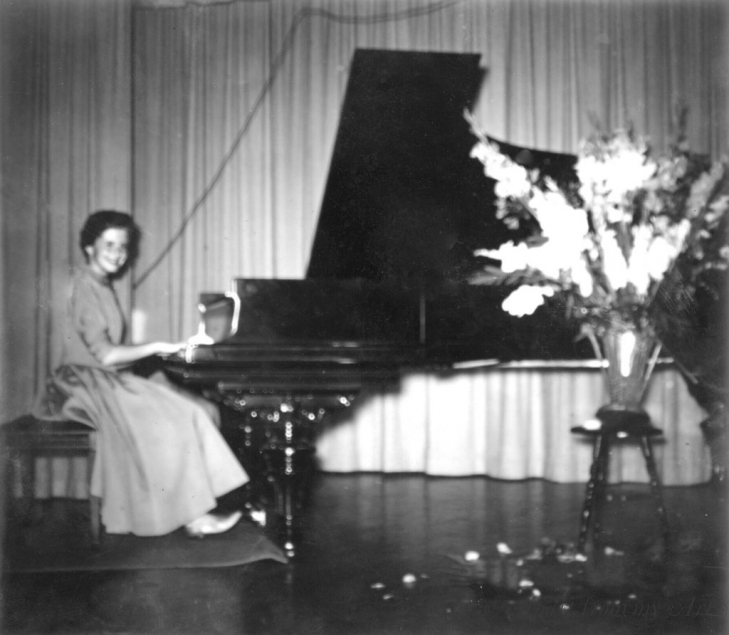Sandra playing the piano at a recital