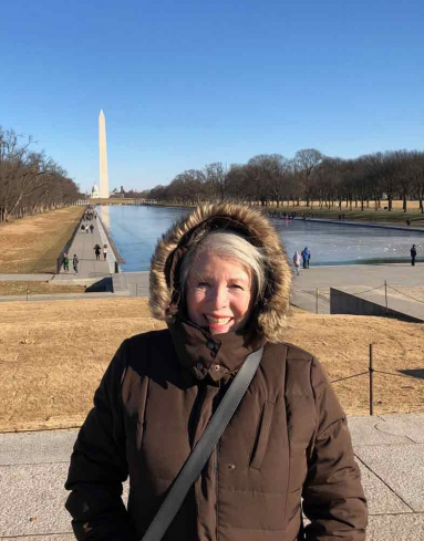 Sandra in front of the Lincoln Memorial Reflecting Pool